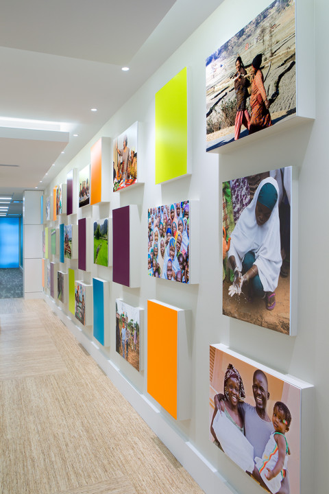 A thirty-foot wall filled with large vibrant photographs highlights the décor and international work of Futures Group. Image courtesy of BBGM.