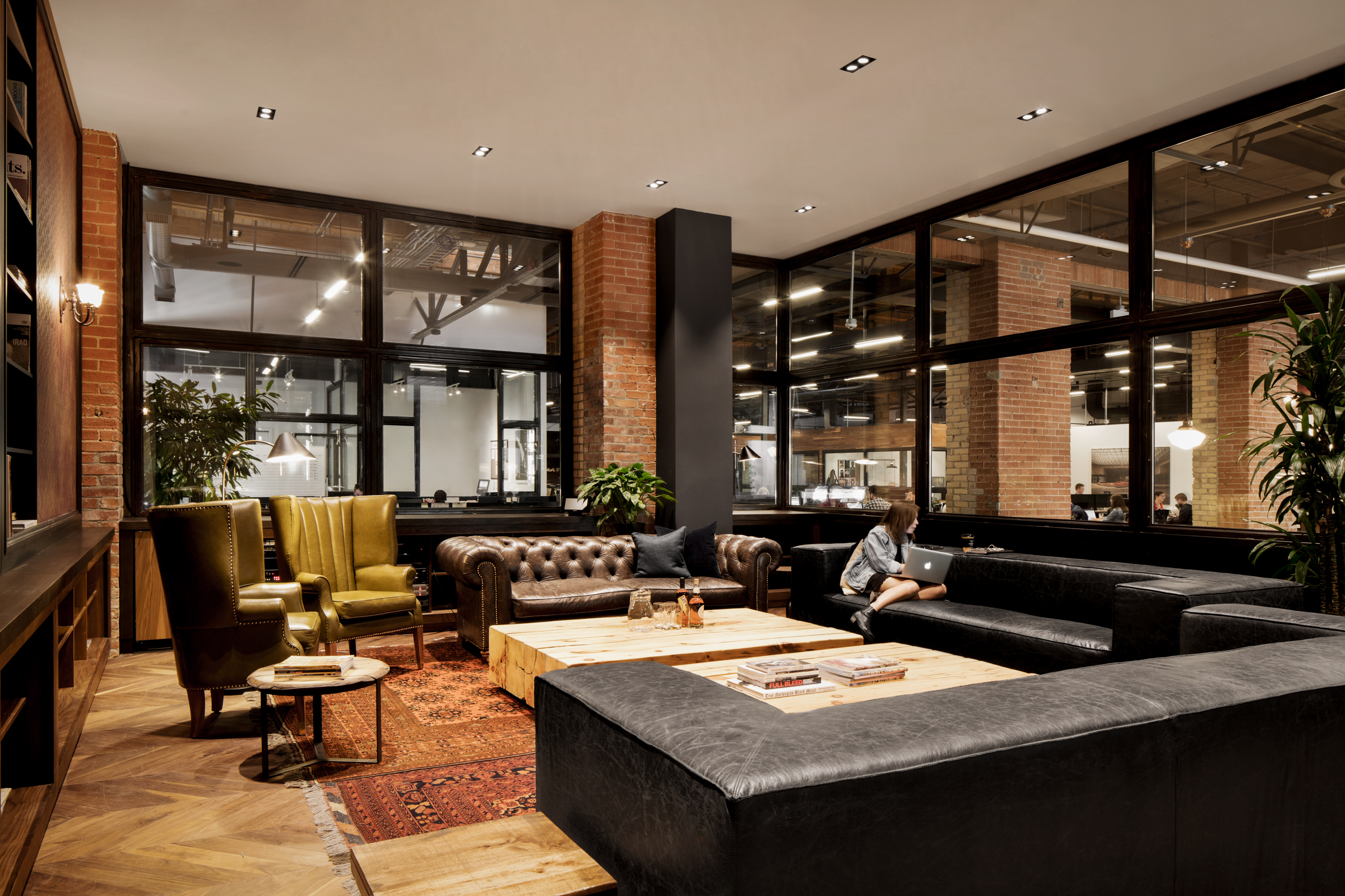 A cigar lounge like office in toronto for Design agency toronto