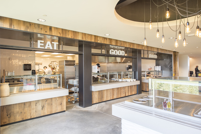 "DFA's ""Eat Good Food"" Cafeteria continues the milky theme of the headquarters. Image courtesy of Dimensional Innovations (Alex Grigsby)."