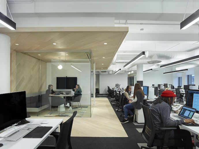 The office features an open plan with numerous breakaway spaces. Image courtesy of Matthew Carbone.