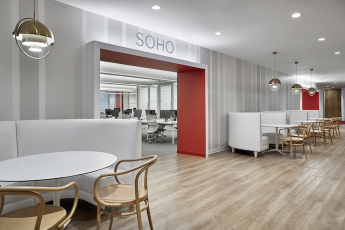 """The creation of small, distinct 'neighborhoods' ... helps employees navigate the office's expansive footprint, and adds color, depth and functionality to the space,"" said Jeff Knoll, a design director at Ted Moudis Associates. Image courtesy of Garrett Rowland."